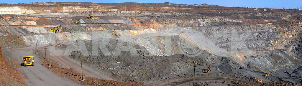 Panorama of an open-cast mine extracting iron ore
