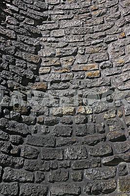 Стара кам'яна вигнута стіна