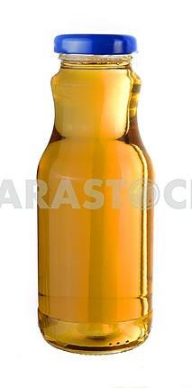 Виноградный сок в маленькой стеклянной бутылке