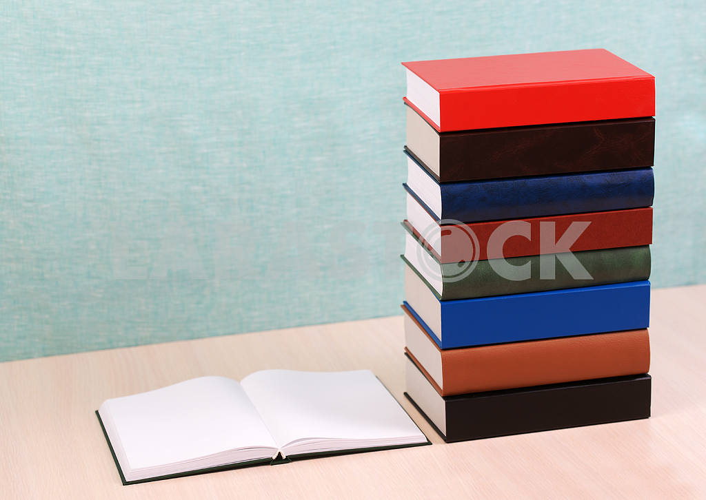 Stack of hardback books on wooden table. Back to school. — Image 46880