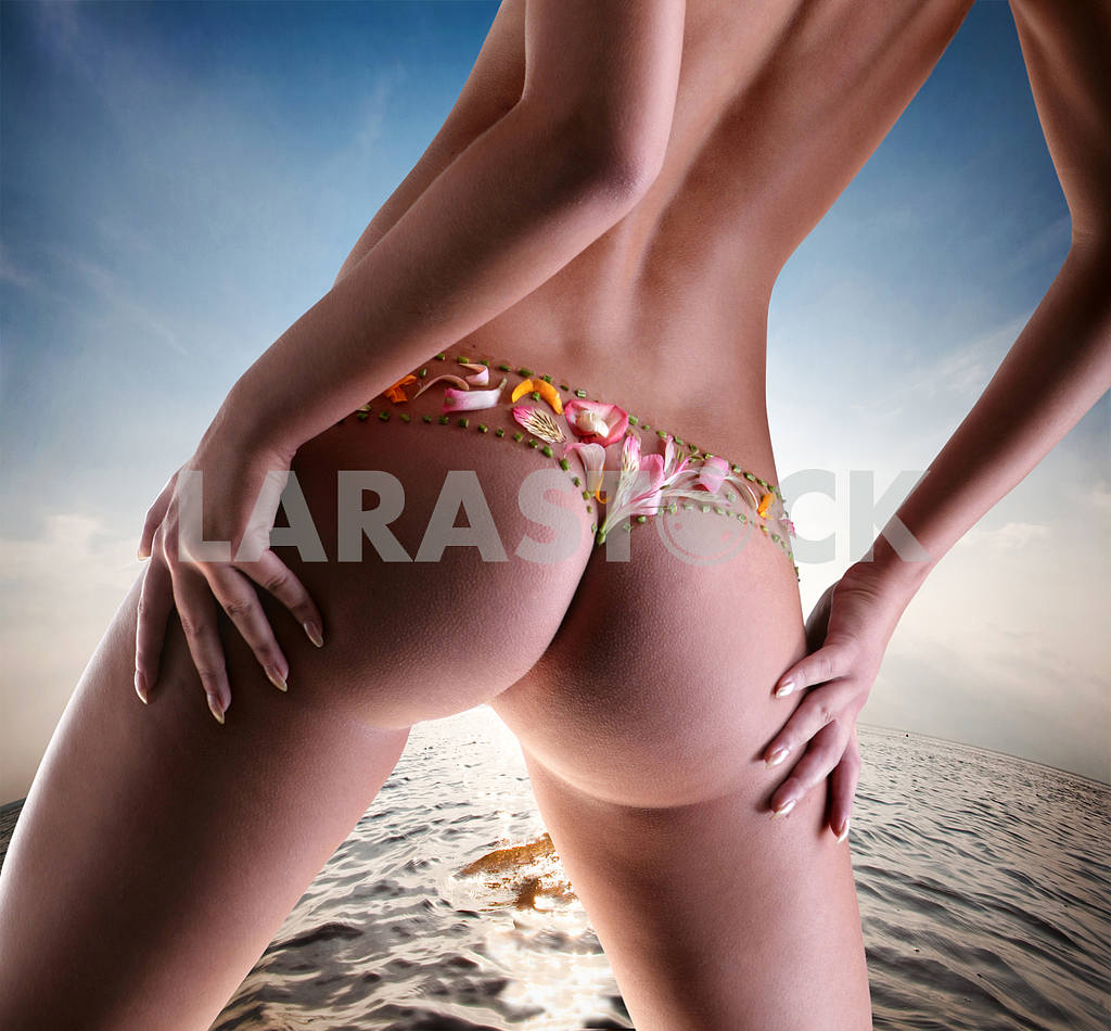 Girl with a flower on buttocks — Image 9090