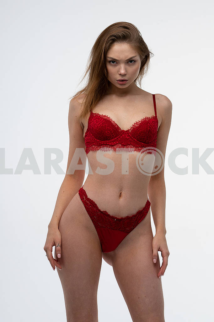 Young beautiful girl pose in studio in red lingerie — Image 82721
