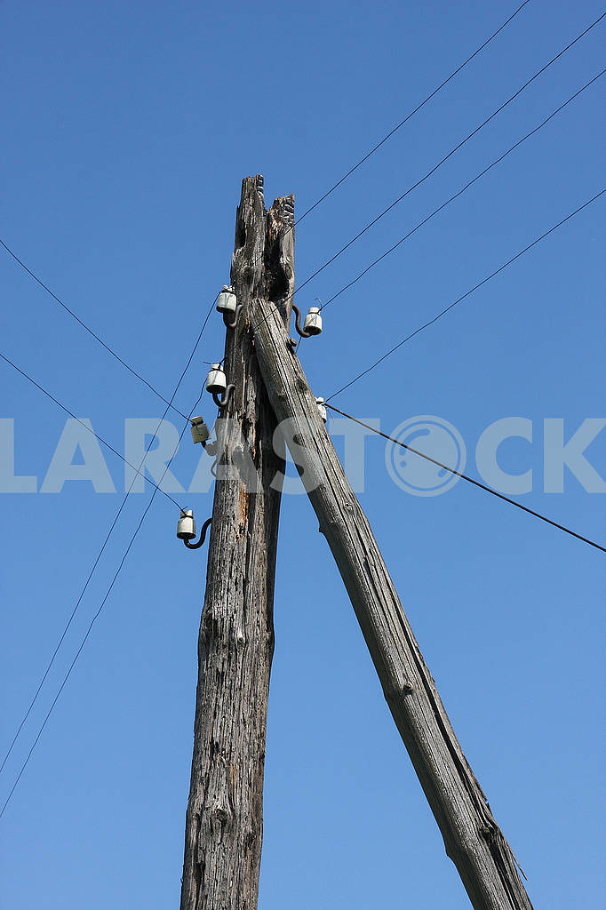 A wooden pole on which electric — Image 67531