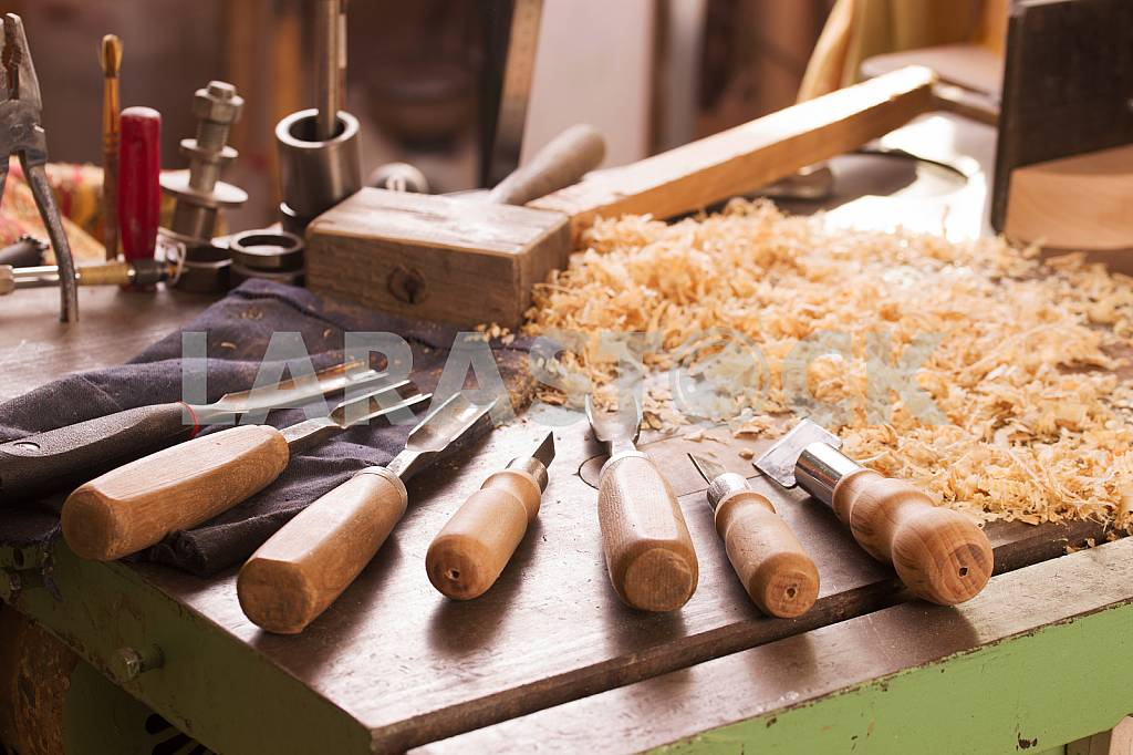 Carpenter tools on wooden table with sawdust. Circular Saw. Carpenter workplace top view — Image 45771