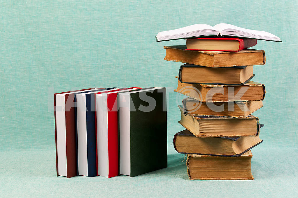 Stack of hardback books on wooden table. Back to school. — Image 47181