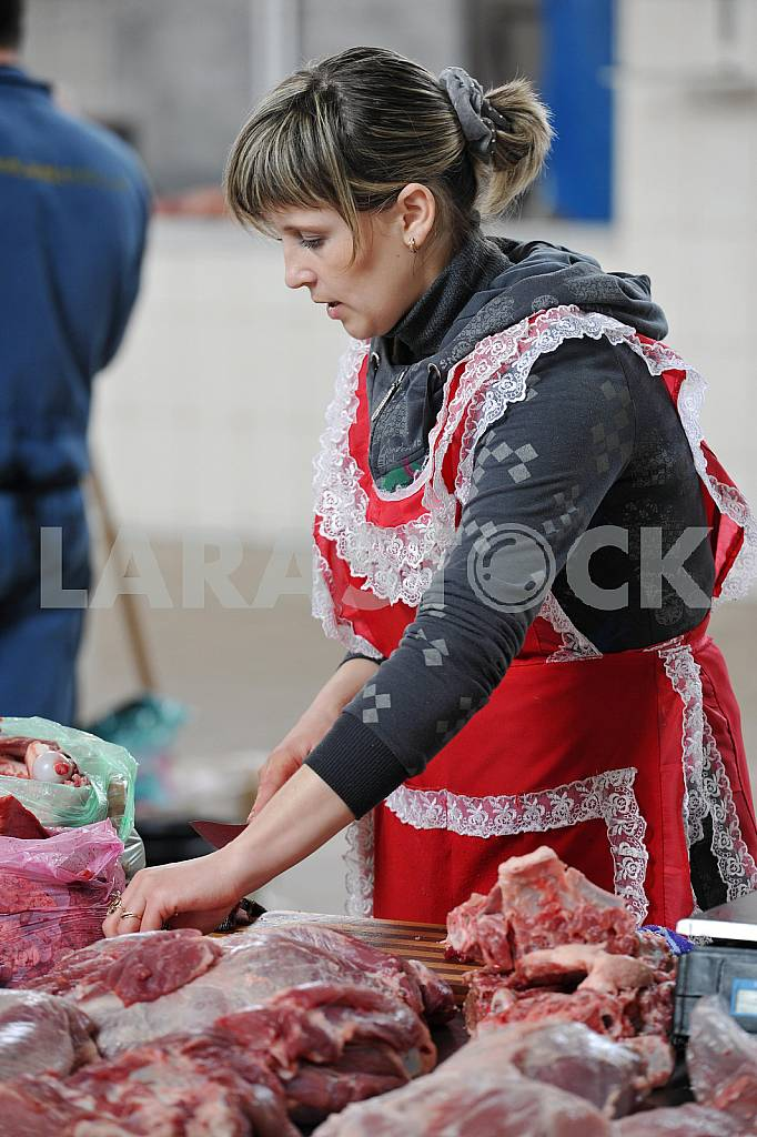 A woman sells meat on the market April 6, 2012 — Image 32932