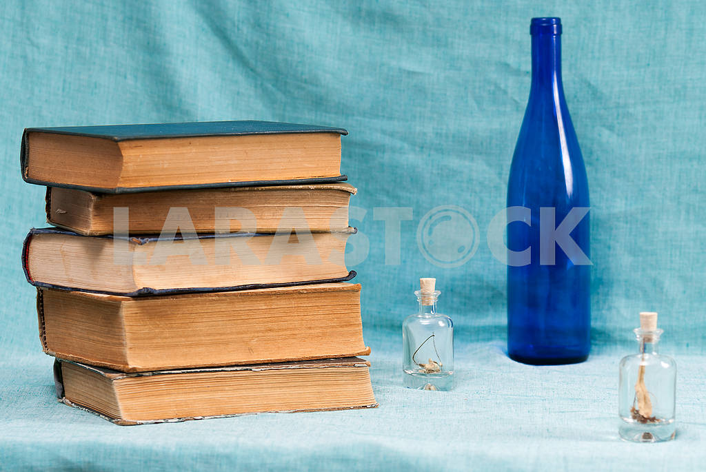 Stack of hardback books on blue cloth. Back to school. Copy space — Image 45332