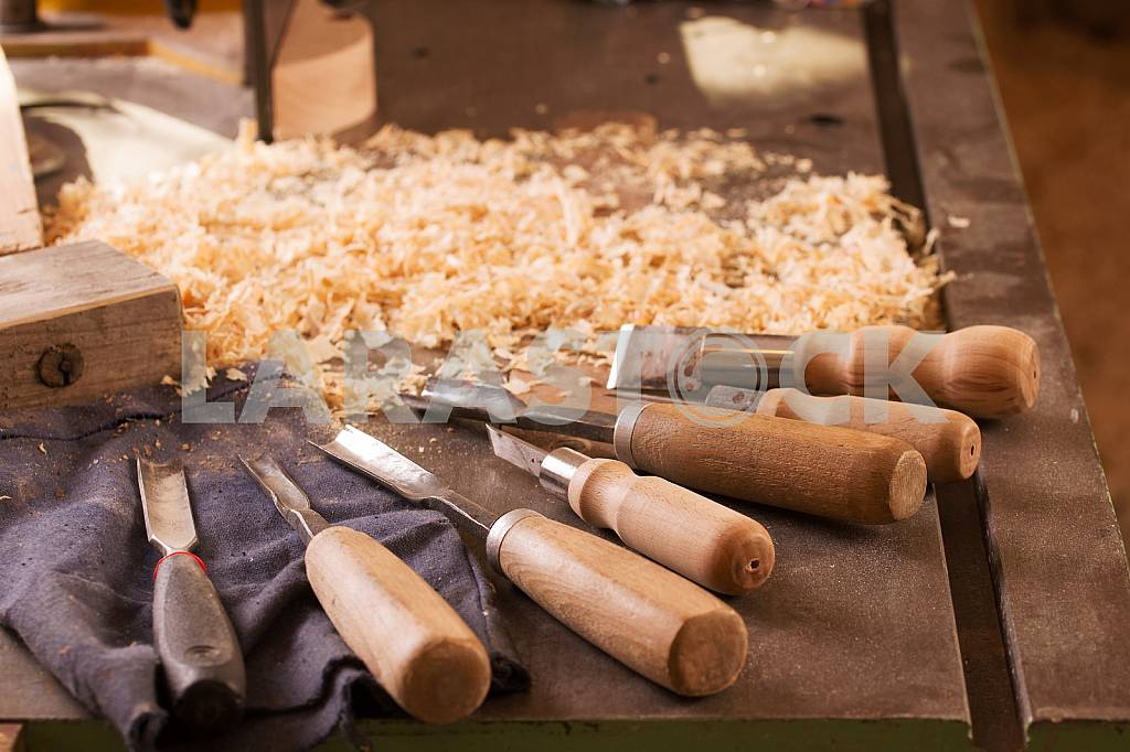 Carpenter tools on wooden table with sawdust. Circular Saw. Carpenter workplace top view — Image 45772