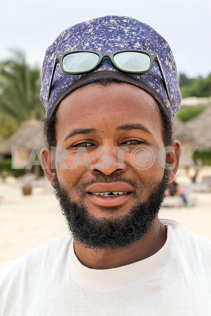 Zanzibar, a man standing near a beach umbrella — Image 32103