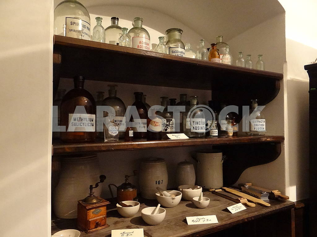 Shelves with bubbles and bottles in an old pharmacy. — Image 66303