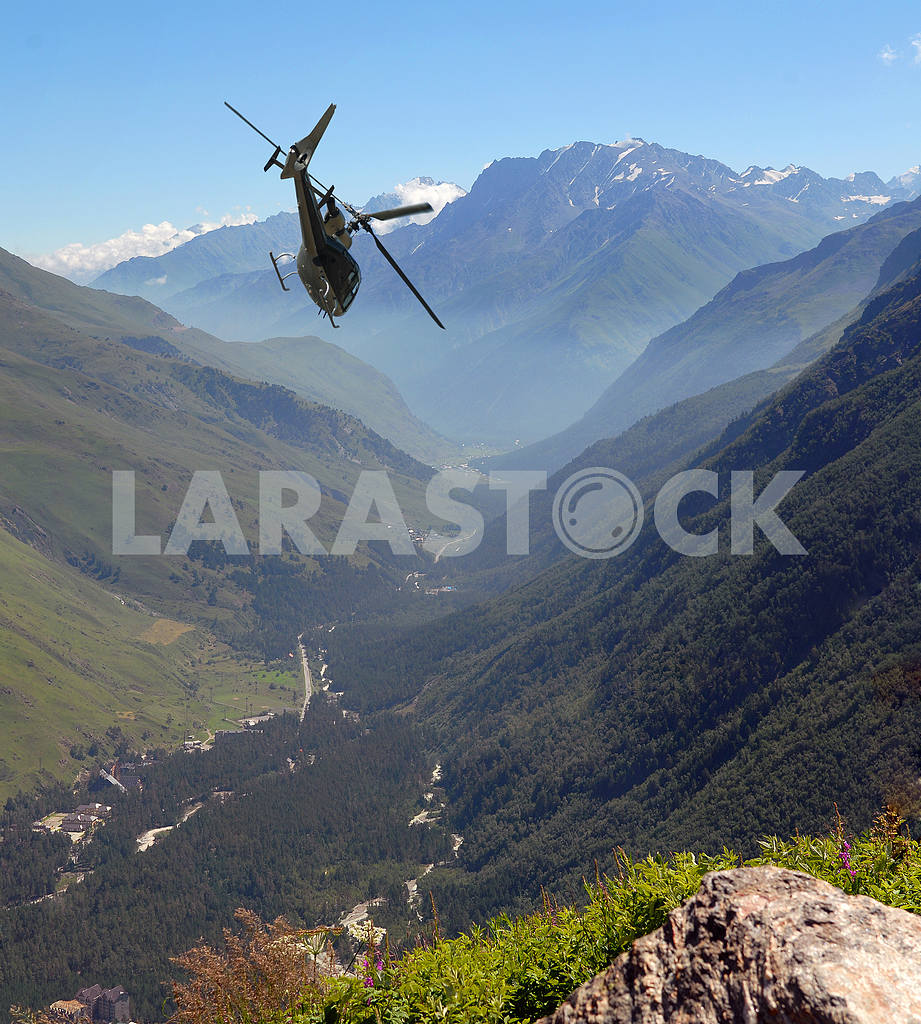 The helicopter flies in mountains — Image 2944
