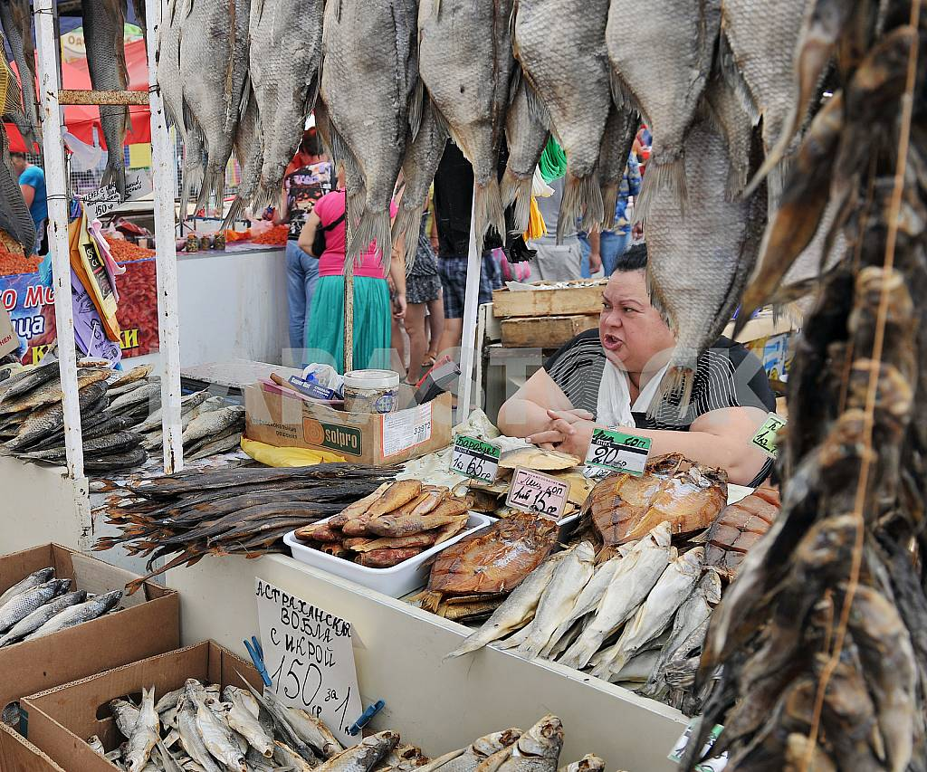 """A woman sells fish in the market """"Privoz"""" July 5, 2012 — Image 32884"""