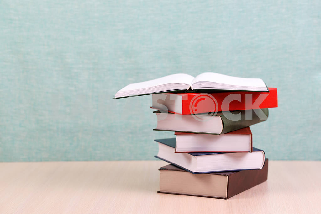 Stack of hardback books on wooden table. Back to school. — Image 46905