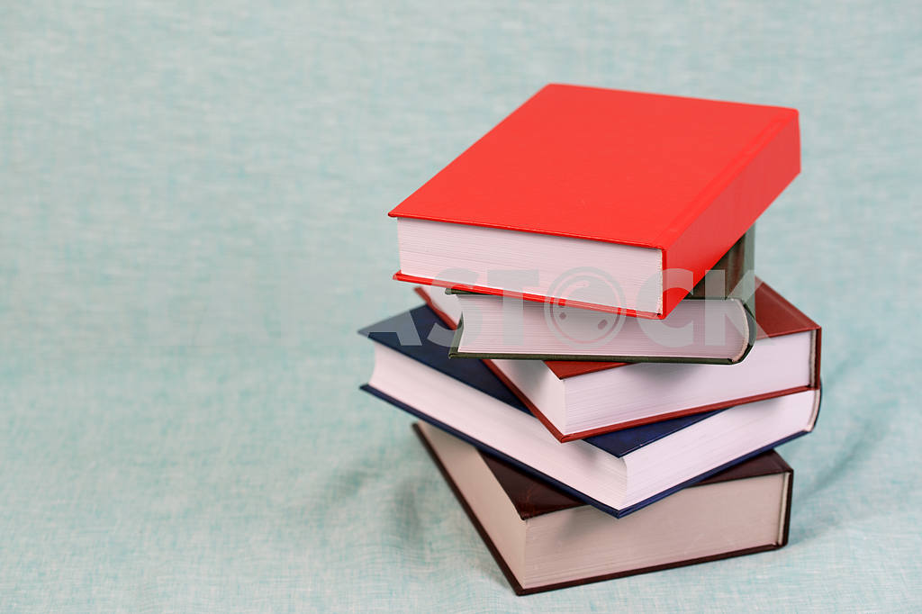 Stack of hardback books on wooden table. Back to school. — Image 47125