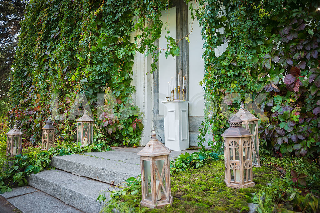 Wedding decorations on the street, outdoor - love out of time theme - vintage Vintage wooden lantern with the candle and moss on the background — Image 39235