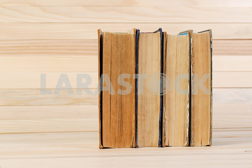 Stack of hardback books on wooden table. Back to school. — Image 47216