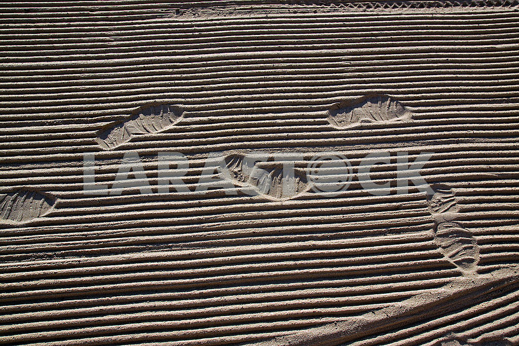 Traces of man on the sand on the Mediterranean Sea beach — Image 68926