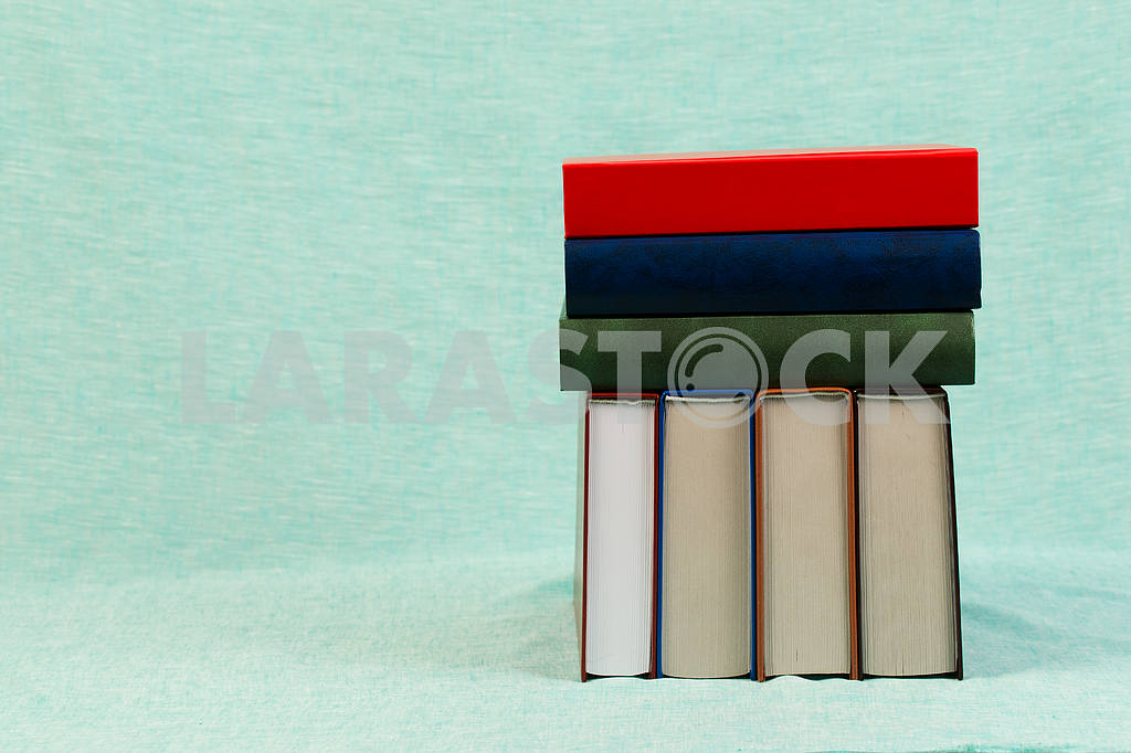 Stack of hardback books on wooden table. Back to school. — Image 47356