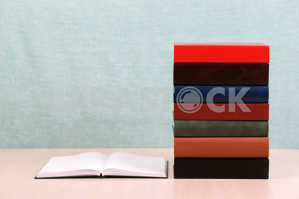 Stack of hardback books on wooden table. Back to school. — Image 46877
