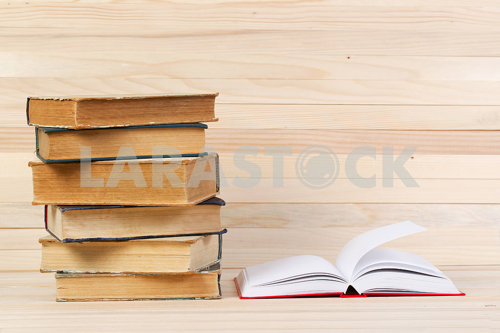 Stack of hardback books on wooden table. Back to school. — Image 47248