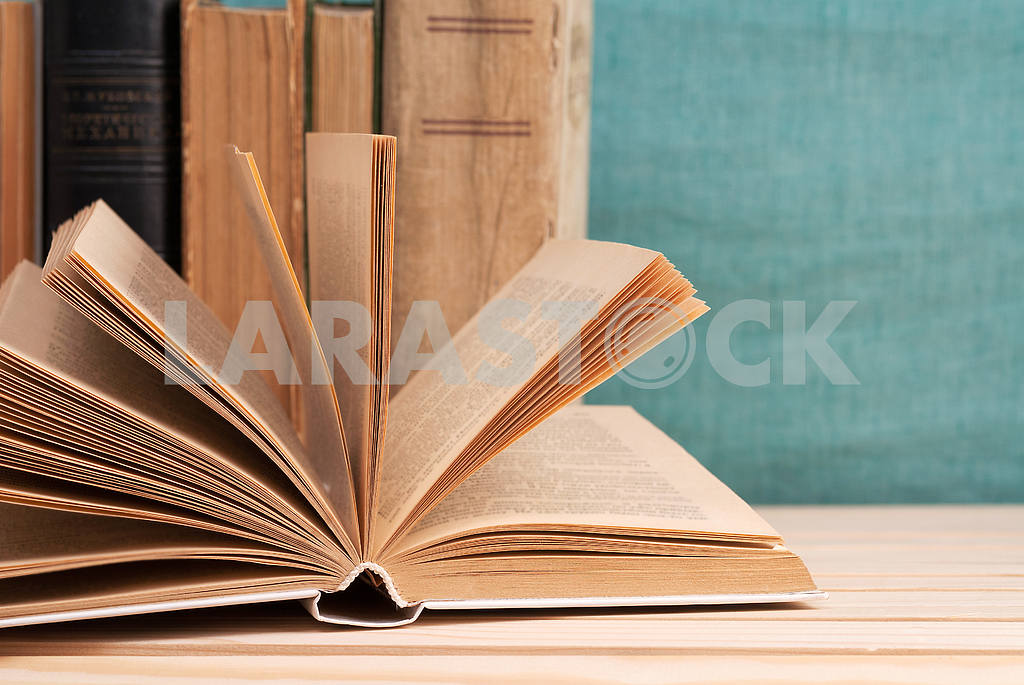 Stack of hardback books on blue cloth. Back to school. Copy space — Image 45348