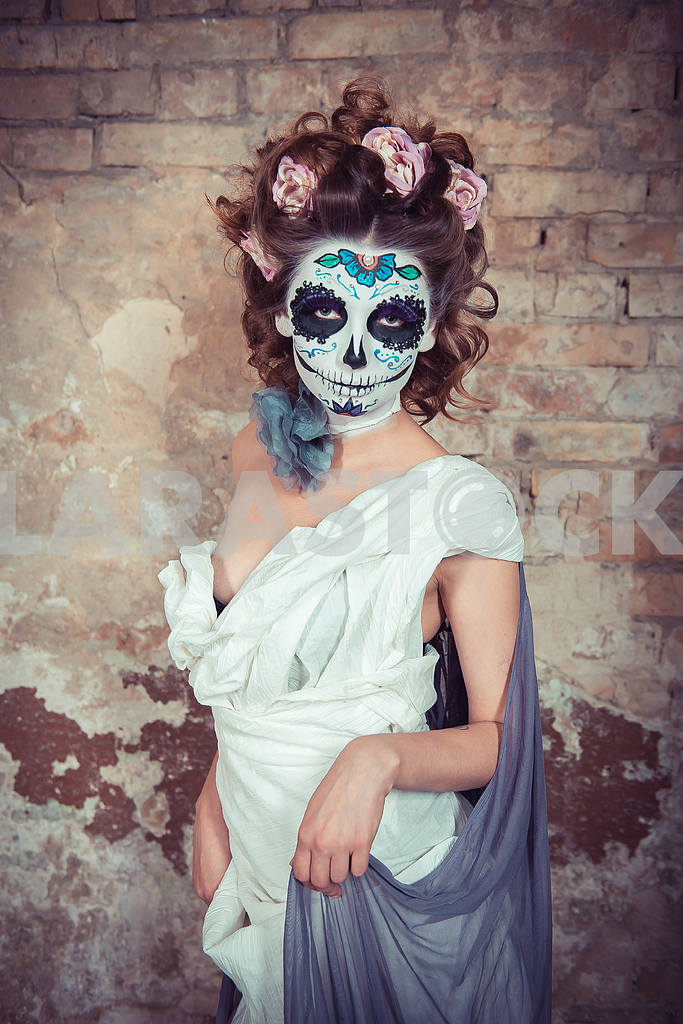 Attractive young woman with sugar skull makeup. Beautiful woman in ...