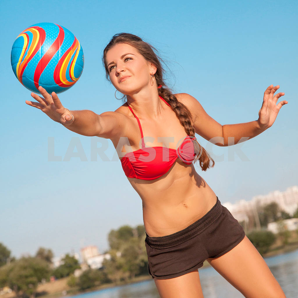 Young beautiful lady is holding volleyball ball — Image 9558