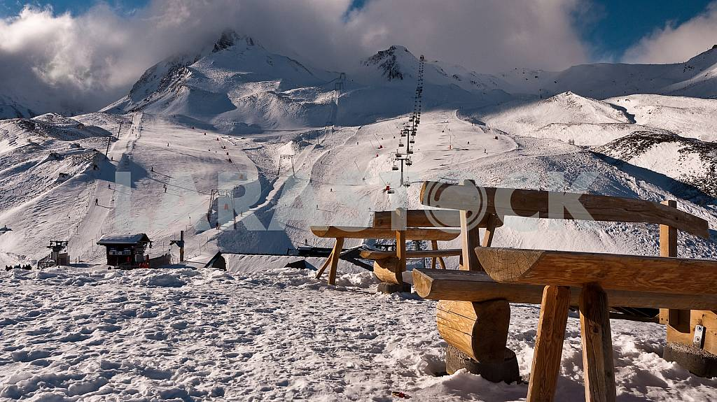 Benches on the background of a mountain with a cloud — Image 26568