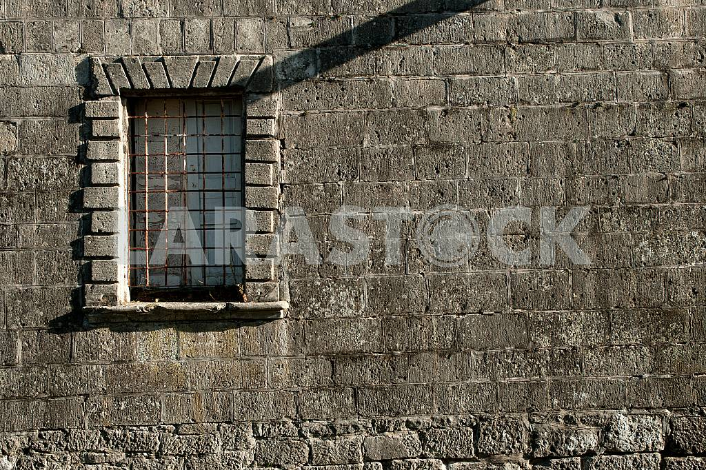 Old stone wall with window and grille — Image 31898