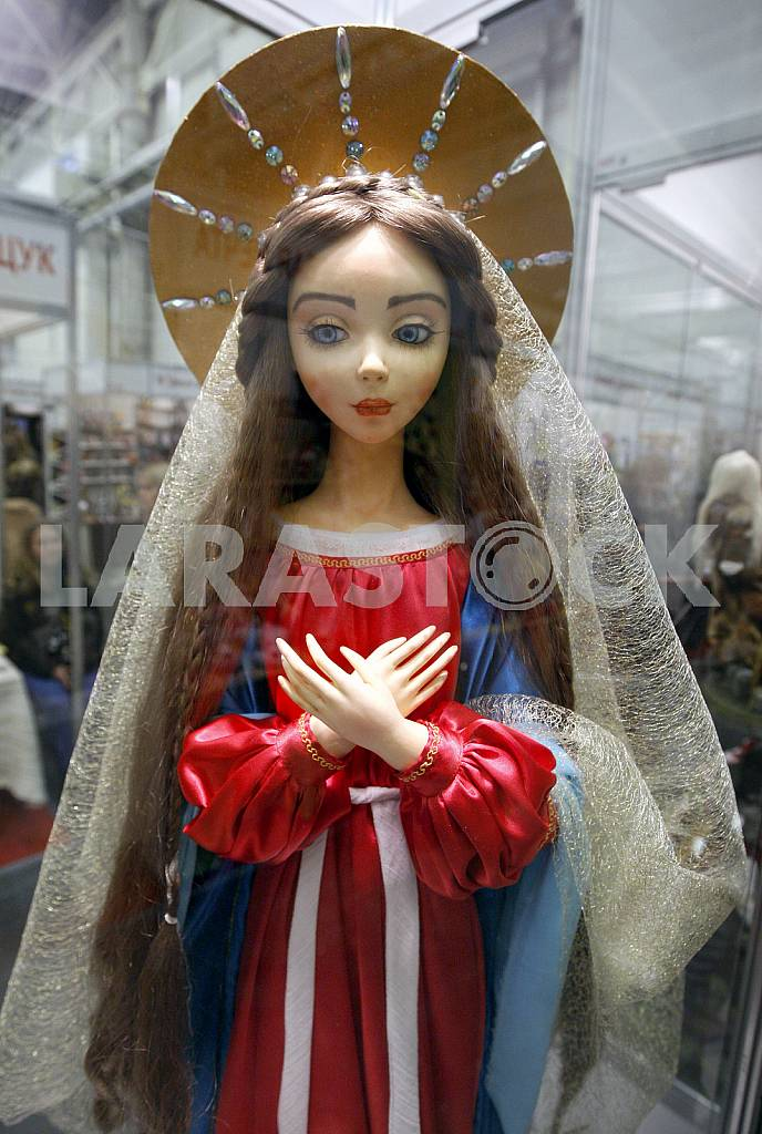 Doll in red and blue dress on the stand — Image 42659