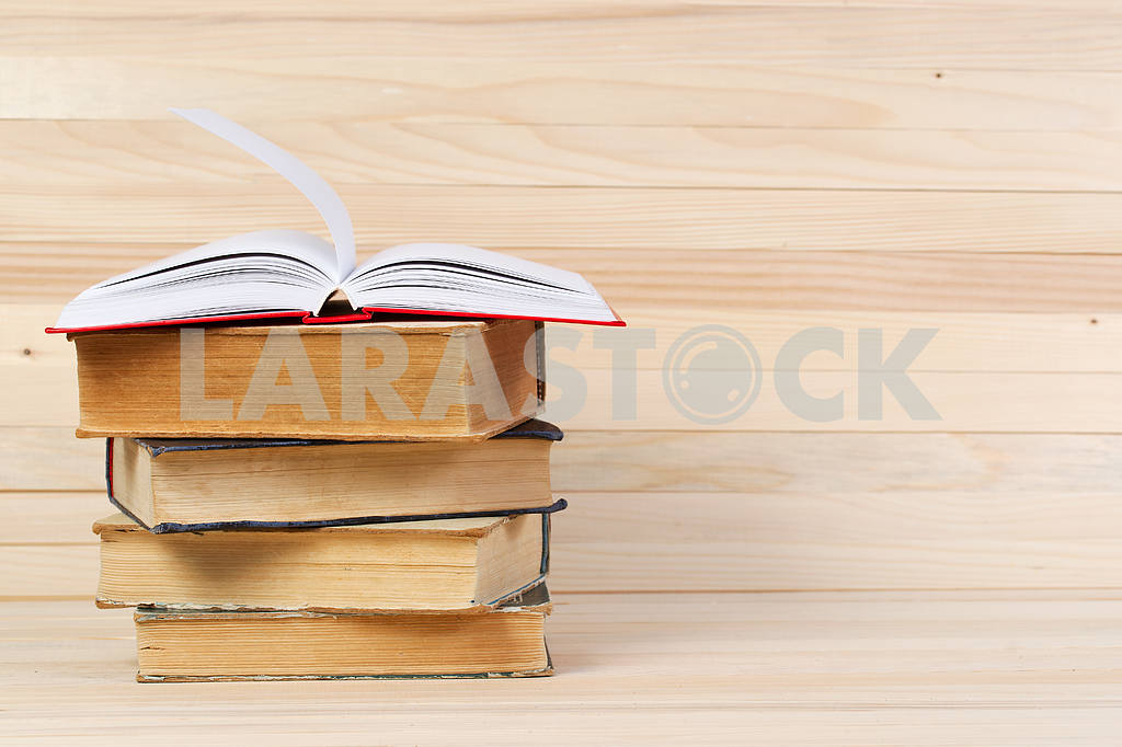 Stack of hardback books on wooden table. Back to school. — Image 47259