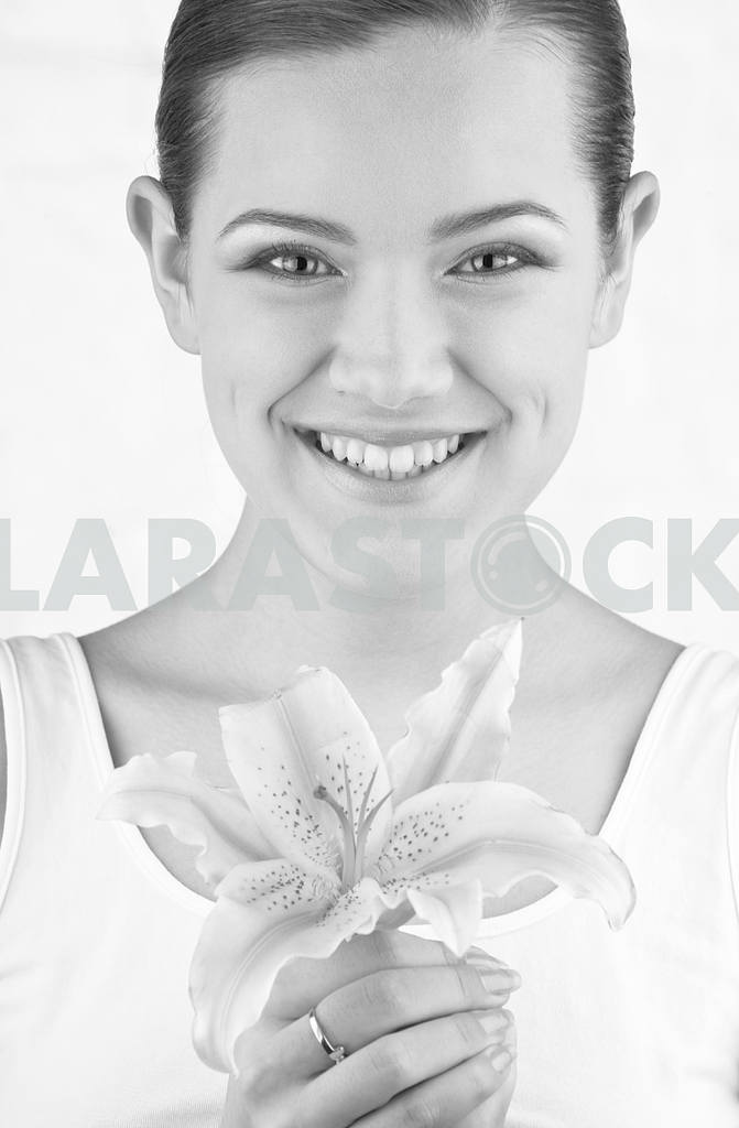 Black and White. Portrait Beautiful girl with flower. Focus on e — Image 10979