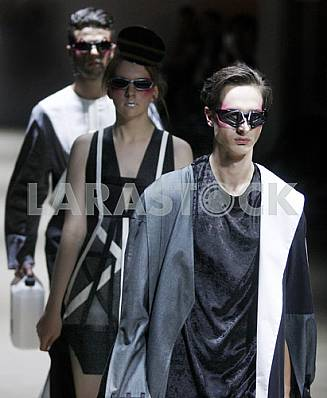 The models in black and white dress demonstrate outfit by Ukrainian designer Kir-Khartley