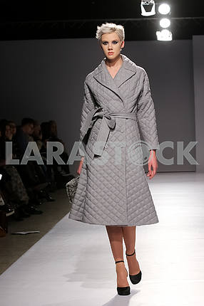 A show by V by Gres, a girl in a gray coat