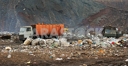 Garbage truck unloading at the dump