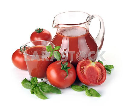 Jug, glass of tomato juice and fruits