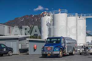 Blue freightliner truck stands near the oil storage