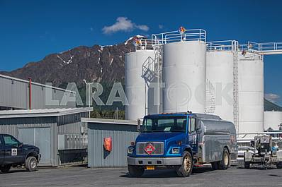 Blue freightliner truck stands near the oil storage