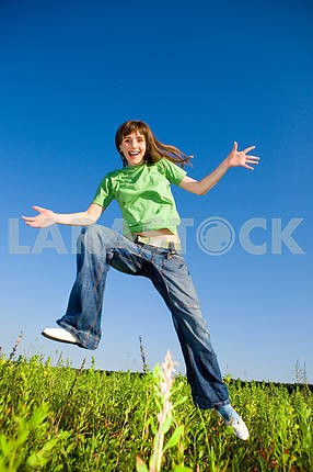 Happy young woman enjoying summer. Jumping.