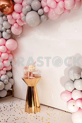 Delicious wedding reception. Birthday Cake on a background balloons party decor. Copy space. Celebration concept. Trendy Cake. Candy bar. Table with sweets, dessert