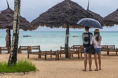 Tourists under an umbrella