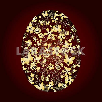 Decorated Easter egg on brown background