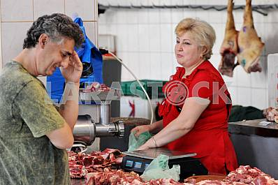 "A woman sells meat on the market ""Privoz"" July 5, 2012"