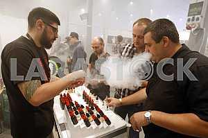 People smoke electronic cigarettes