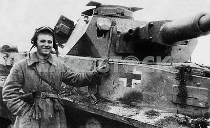 Soviet soldier near a tank
