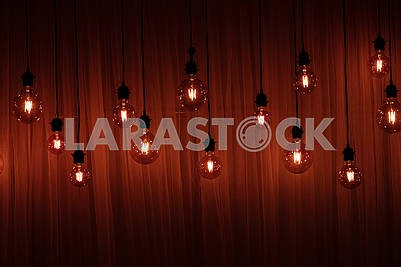 Christmas lights isolated. Garlands of lamps on a wooden ceiling background