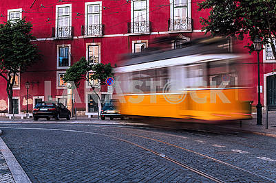 Historic classic yellow tram of Lisbon built partially of wood Portugal