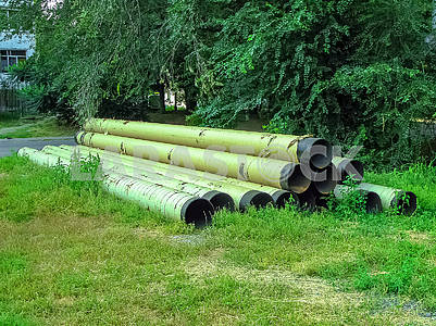 Large water pipes lie on the ground