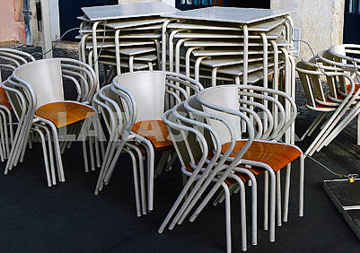 Folding chairs and tables of a street cafe