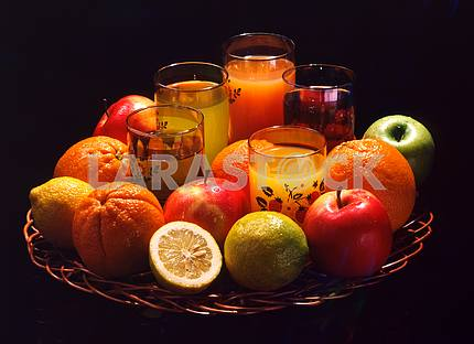Vase with fruits and juices